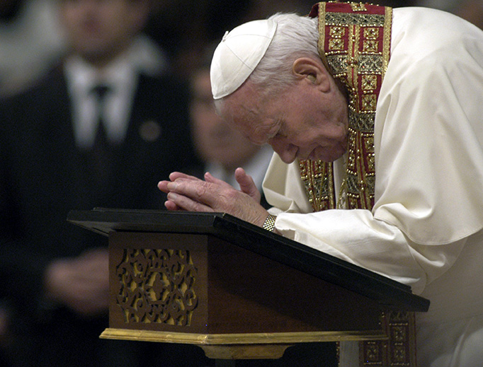 Pope St. John Paul II prays at St. Peter's Basilica on the Feast of the Presentation of the Lord, Feb. 1, 2003.