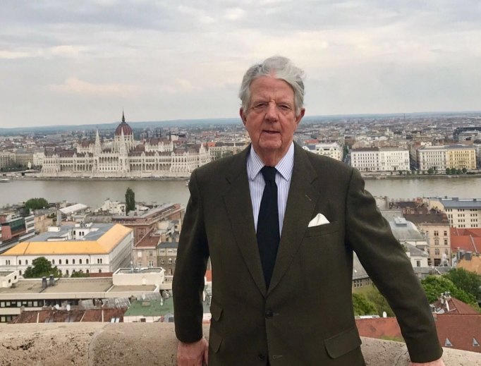 Archduke Michael Habsburg-Lothringen poses in front of the Hungarian Parliament.