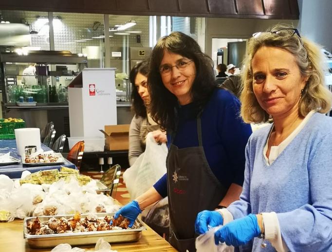Caritas Milan helping to prepare groceries for those in need during Italy's coronavirus quarantine.