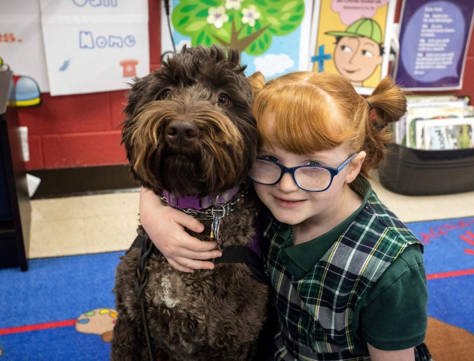 Hadley Jo Lange and her faithful service dog, Ariel, are the best of friends.
