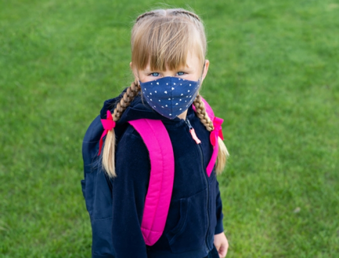 A young girl is prepared for school amid the coronavirus pandemic.