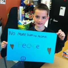 'No more hurting people. Peace,' reads the poster held by Martin Richard, the youngest life lost on Marathon Monday last year.