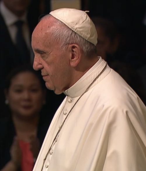 Pope Francis stands as delegates applaud at the conclusion of his Sept. 25 address to the U.N. General Assembly.
