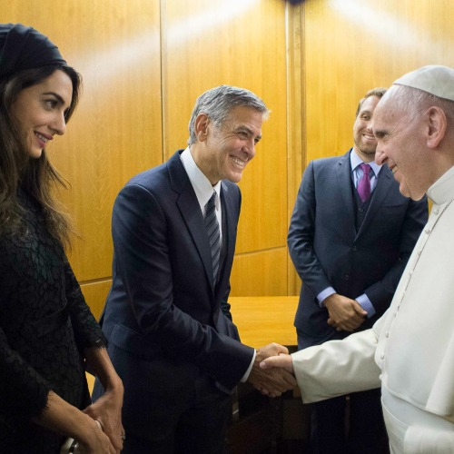 Pope Francis meets George and Amal Clooney at the Vatican May 29, 2016.