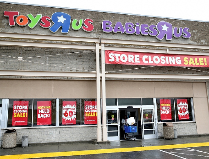 A customer leaves a Toys R Us store March 15 in Emeryville, California. Toys R Us filed for liquidation in a U.S. bankruptcy court and plans to close 735 U.S. stores, leaving 33,000 workers without employment.