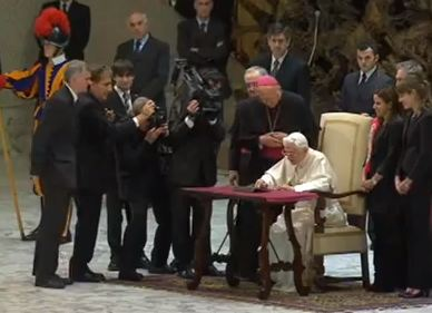 Pope Benedict XVI sending his first tweet from @pontifex at the end of his weekly general audience, Dec 12, 2012.