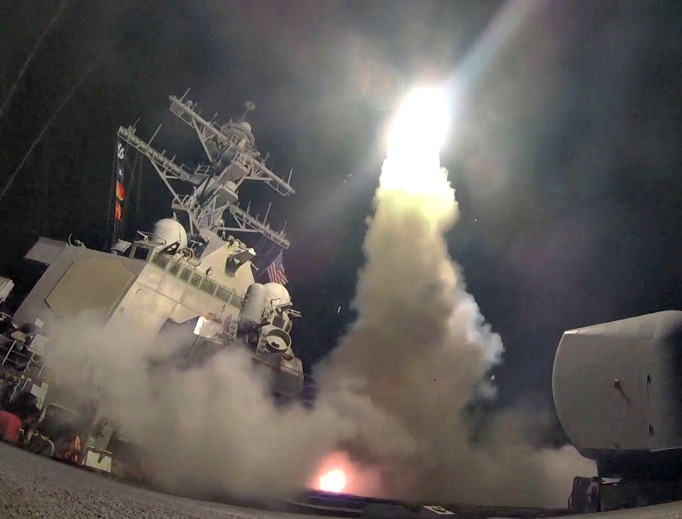 In this April 7 image provided by the U.S. Navy, the guided-missile destroyer USS Porter launches a tomahawk land-attack missile in the Mediterranean Sea as the United States blasted a Syrian air base with a barrage of cruise missiles in retaliation for a purported chemical-weapons attack against civilians earlier in the week.
