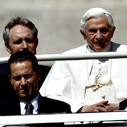 Paolo Gabriele (bottom left), arrives with Pope Benedict XVI at St. Peter's Square. The butler, who serves in the apartments of the Holy Father, was arrested May 25 in connection with an investigation into leaks of confidential documents. Now he will stand trial.