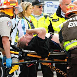 A man is loaded into an ambulance after he was injured by one of two bombs exploded during the 117th Boston Marathon near Copley Square on April 15 in Boston.