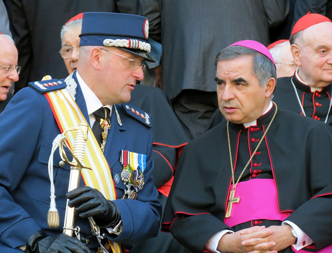 Domenico Giani and then-Archbishop Angelo Becciu attend the Gendarmes' parade at the Vatican for the feast of St. Michael the Archangel on Oct. 5, 2012.