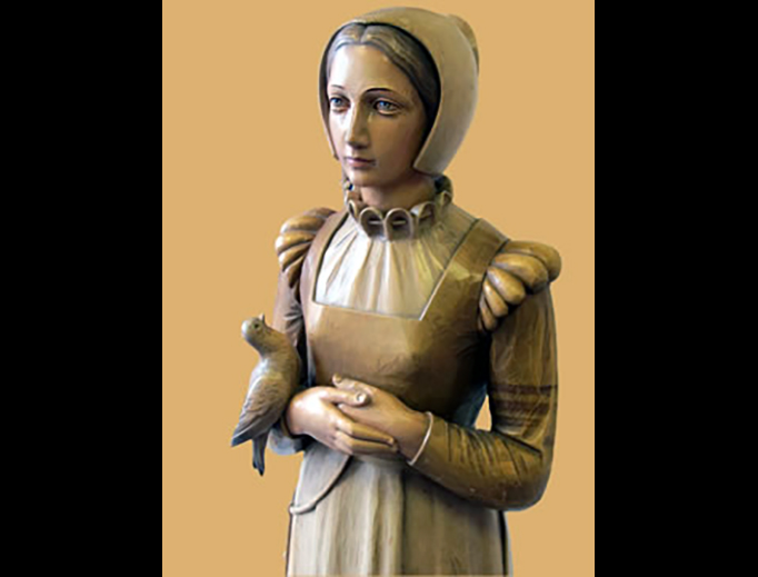 This statue of St. Anne Line stands in St. Anne Line Junior School in Basildon, Essex, England.