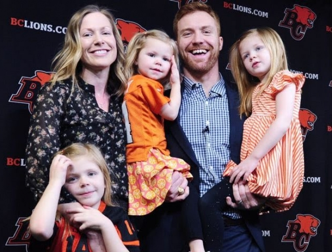 Travis Lulay, accompanied by wife Kim and three daughters, attends a retirement press conference in February 2019.