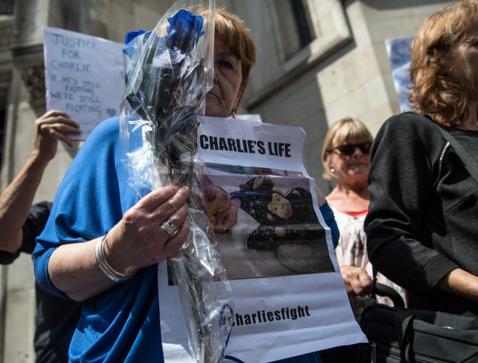 Supporters of Chris Gard and Connie Yates, the parents of terminally ill baby Charlie Gard, take part in a demonstration outside the U.K. High Court as Gard and Yates attend a case relating to their son on July 10.