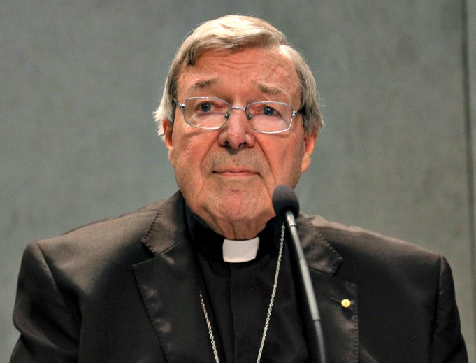 Cardinal George Pell holds a news conference at the Vatican, June 29. The cardinal said he will return to Australia to defend himself against sexual assault charges.