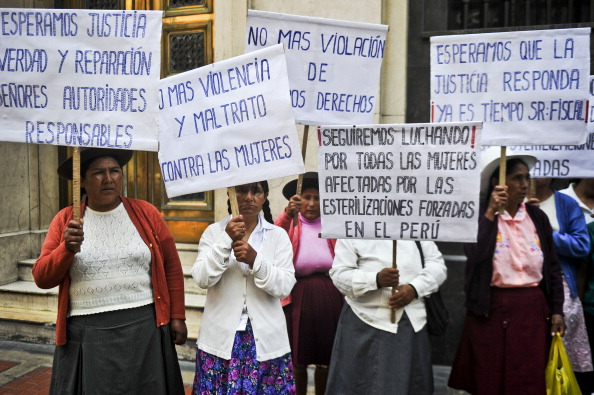 Peruvian Andean women victims of forced sterilizations during the administration of Peru's former President Alberto Fujimori protest in Lima Feb. 13, 2014.