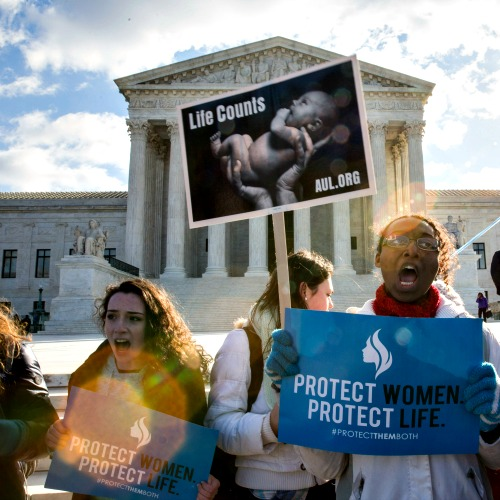 Pro-life advocates rally outside of the Supreme Court on March 2 in Washington. The court considered a Texas law requiring that abortion-business doctors have admitting privileges at local hospitals and that the abortion facilities upgrade their health standards similar to hospitals.