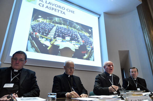 Cardinal Lorenzo Baldisseri, second from left, at last week's Vatican conference on the synod.