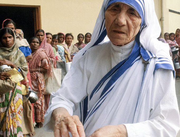 Mother Teresa of Calcutta serves the poor Dec. 5, 1980, at her mission in Calcutta, India.