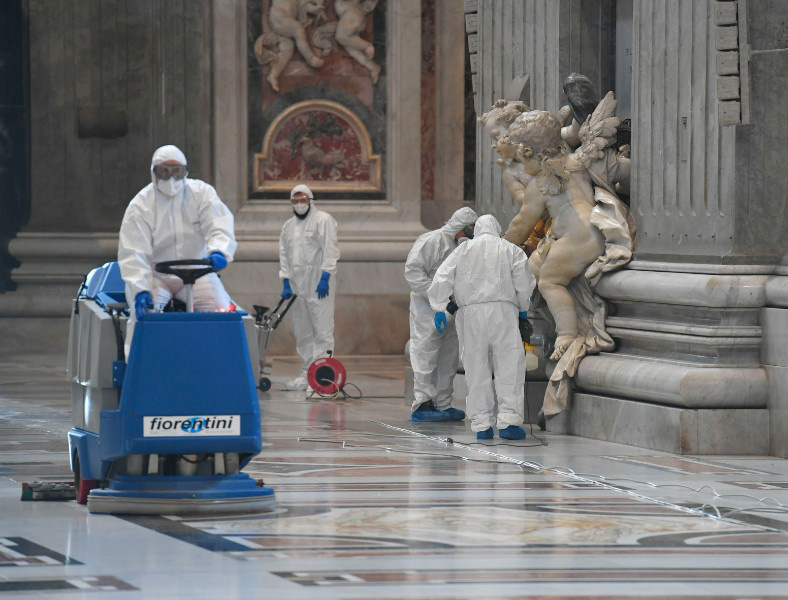 Workers sanitize St. Peter's Basilica May 15 in preparation for the resumption of public ceremonies.