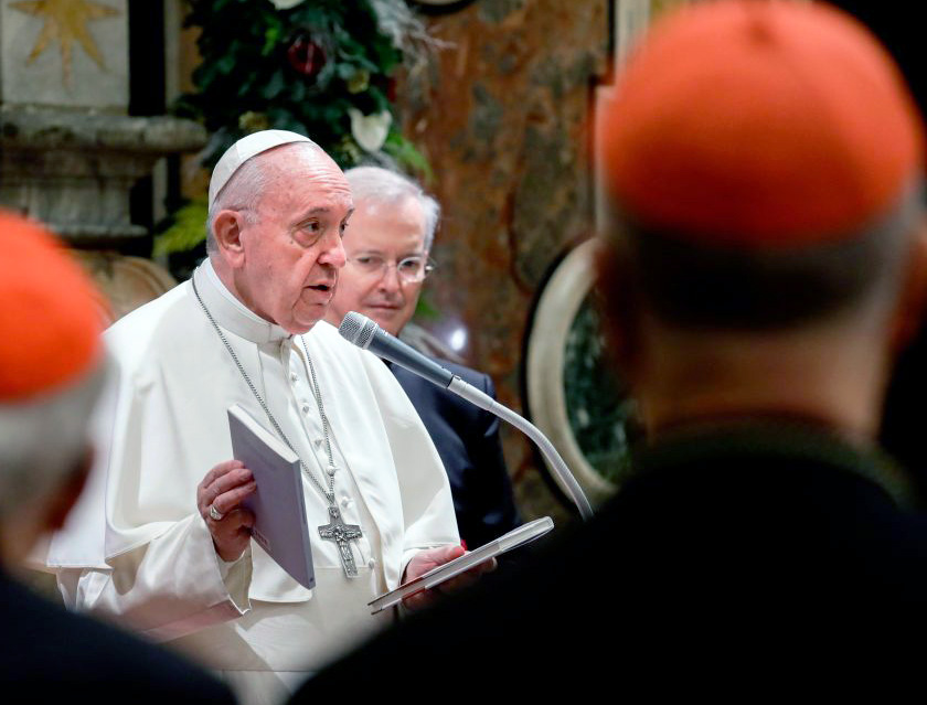 Pope Francis holds two books he presented as a gift to cardinals and bishops on the occasion of his Christmas greetings to the Roman Curia, Dec. 21, 2019, in the Clementine Hall at the Vatican.