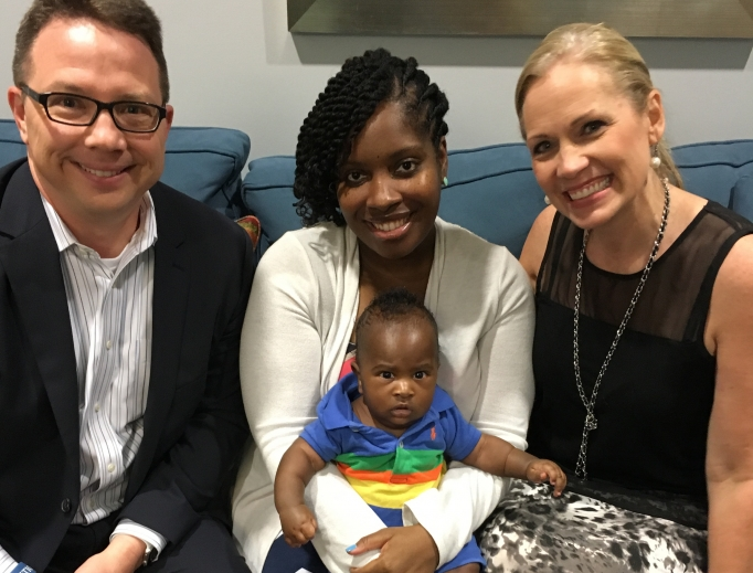 Founder Brian Fisher, a client with her baby, and Rachelle Fletcher, a staffer at  Human Coalition's Grapevine, Texas, clinic near Dallas.