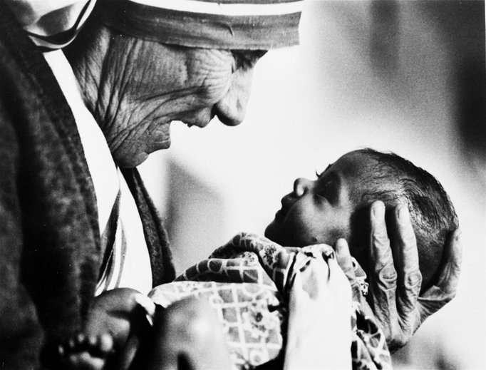 Mother Teresa cradles an armless baby girl at a Missionaries of Charity orphanage in Kolkata, India, in 1978. A champion among the poorest of the poor, Mother Teresa will be canonized Sept. 4 at the Vatican.