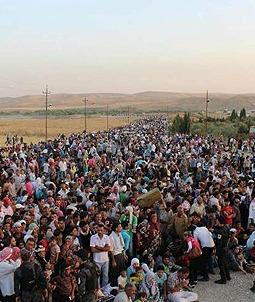 Syrian refugees pour into Iraqi Kurdistan.