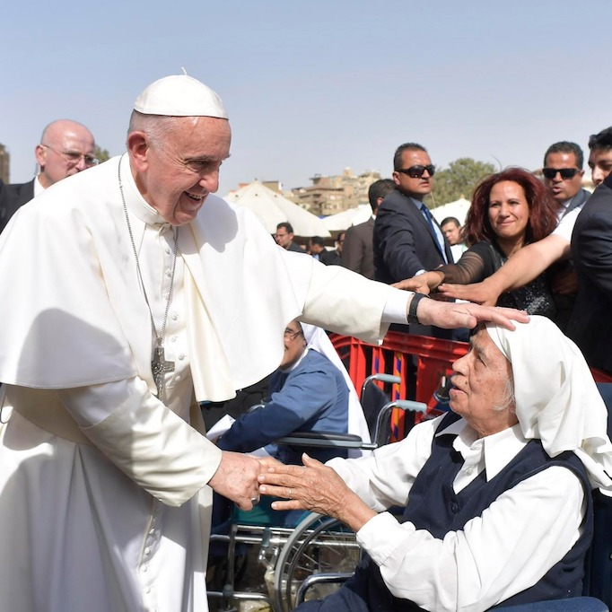 Pope Francis greets a religious sister April 29 in Cairo.