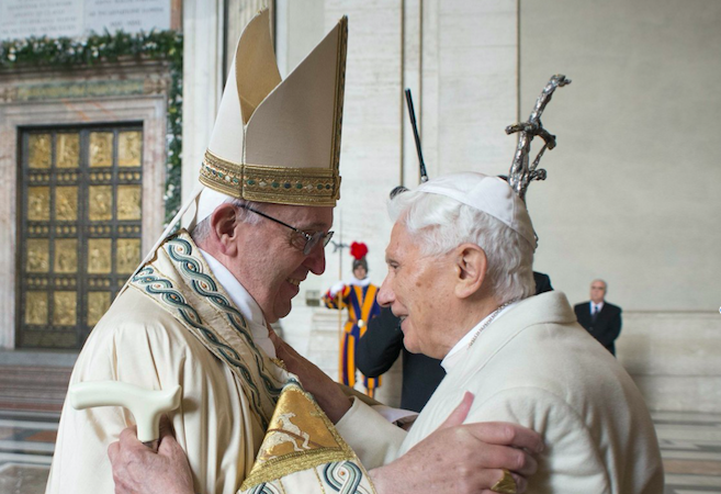 Pope Francis and Pope Emeritus Benedict XVI outside of the Holy Doors at St. Peter's Basilica to begin the Jubilee Year of Mercy on December 8, 2015, the feast of the Immaculate Conception.