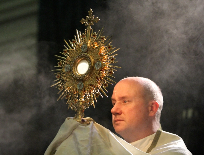 Franciscan Father David Pivonka, class of 1989, shown elevating the Eucharist during adoration, was elected the seventh president of Franciscan University of Steubenville on May 21.