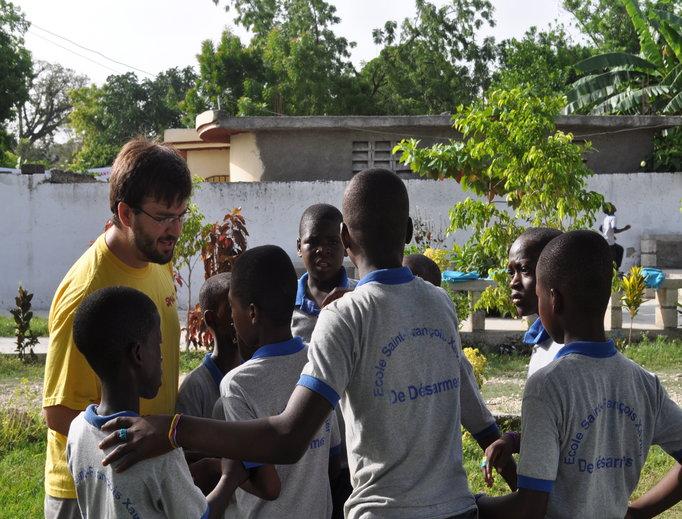 Seminarian Jimmy Morgan with young Haitians