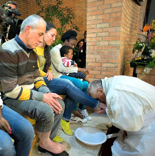 Pope Francis washes the feet of detainees and inmates at the Rebibbia Prison off of the Via Tiburtina in Rome on Holy Thursday, April 2, 2015.