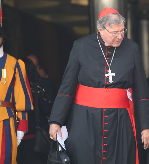 Cardinal George Pell leaves the Vatican's Synod Hall after a session of the synod on the family on Oct. 13, 2014.