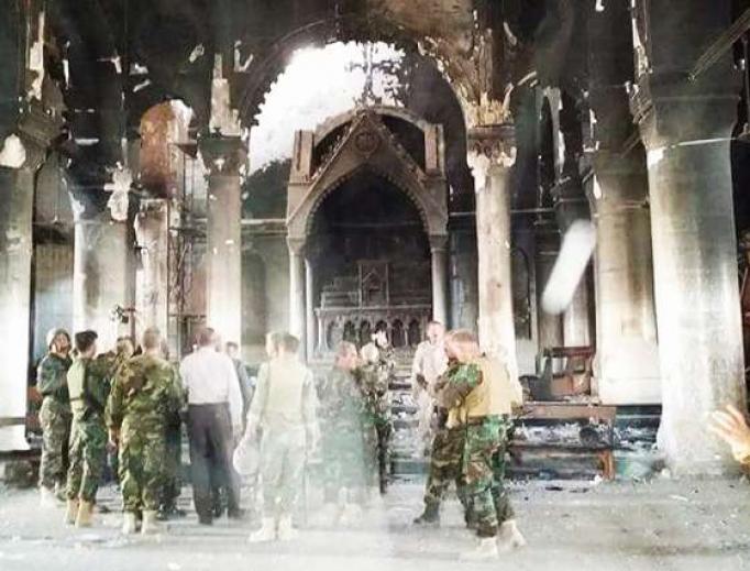 Pershmerga fighters inspect Al Tamera Syriac Catholic parish in Qaraqosh, Iraq, after the city's recent liberation from the Islamic State.