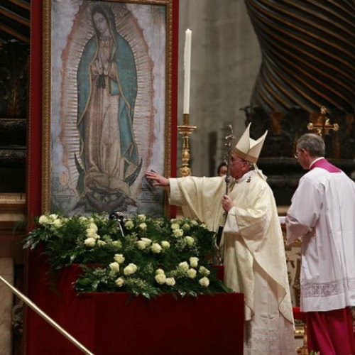 Pope Francis venerates an image of Our Lady of Guadalupe while celebrating Mass in St. Peter's Basilica on Dec. 12.