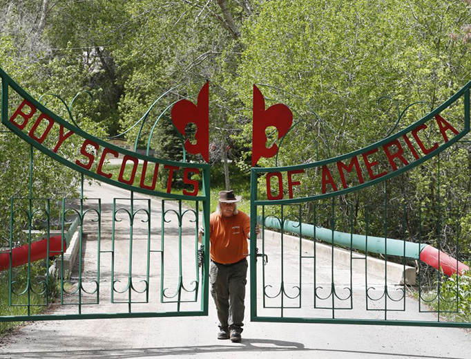 Mark Veteto, Camp Ranger for the Maple Dell Scout Camp, owned by the Utah National Park Council of the Boy Scouts of America, closes the front gate for the day on May 9, 2018 outside Payson, Utah.