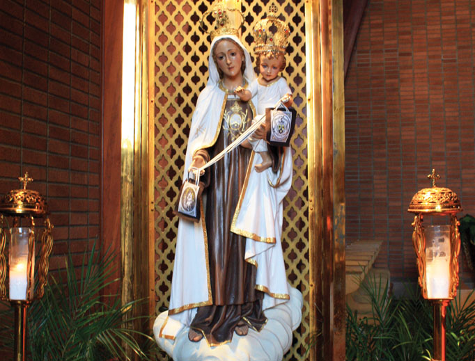 A statue of Our Lady of Mount Carmel from Portugal that dates to the 1940s is on display, along with other Marian imagery.