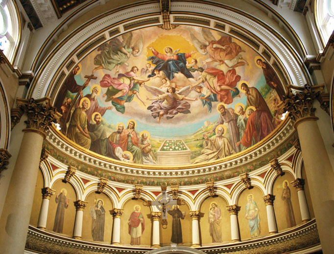 The ornate dome draws eyes upward in the first Catholic church built in New England by Italian immigrants. Marian and saints' images decorate the sanctuary.