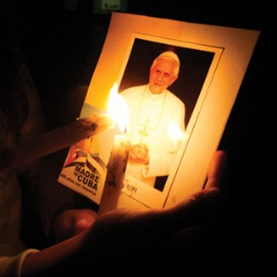 PRAYERFUL PREPARATION. Cuban Catholics carry candles and pictures of Pope Benedict XVI during a Stations of the Cross procession in Havana March 7 in advance of the Holy Father's visit.