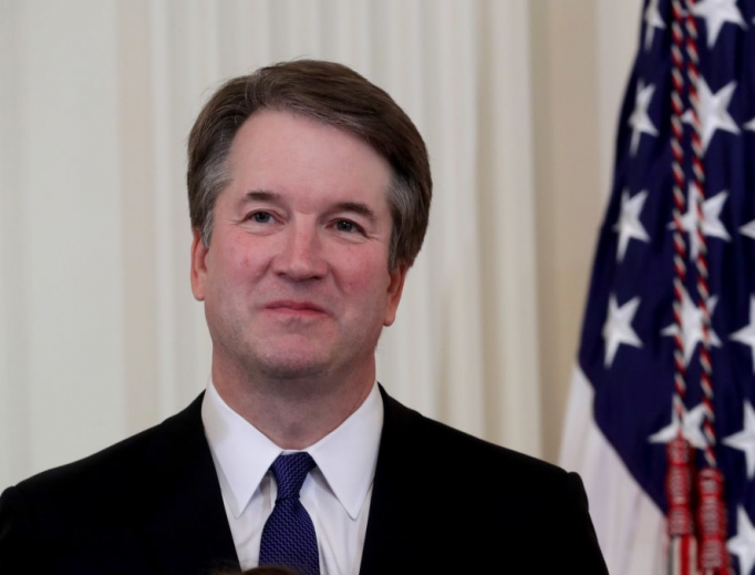 U.S. Circuit Judge Brett Kavanaugh looks on as U.S. President Donald Trump introduces him as his nominee to the U.S. Supreme Court during an event in the East Room of the White House July 9. Pending confirmation by the U.S. Senate, Judge Kavanaugh would succeed Associate Justice Anthony Kennedy, 81, who is retiring after 30 years of service on the high court.