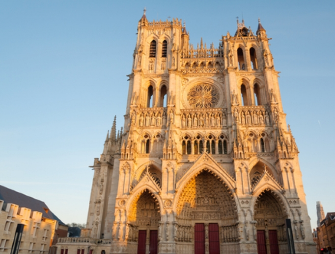 Cathedral Basilica of Our Lady of Amiens in setting sun.