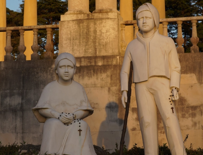 Statues in Fatima of soon-to-be saints Francisco and Jacinta Marto remind the faithful that Mary appeared as Our Lady of the Rosary.