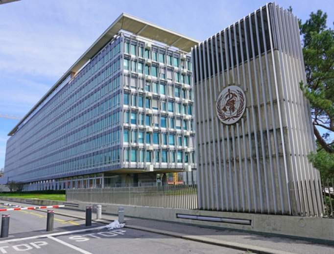 Exterior view of the building of the World Health Organization (OMS WHO), a United Nations international organization located in Geneva, Switzerland.