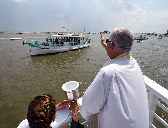 Fr. Greg Barras blesses a boat
