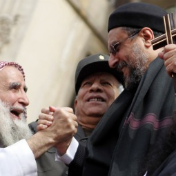 SEEKING PEACE. A Christian cleric clasps hands with a Muslim sheik during a rally to demonstrate unity between Muslims and Christians in Tahrir Square in Cairo, Egypt, March 11. The rally took place after recent sectarian clashes left 13 people dead.