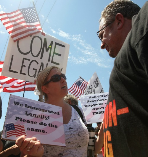 An opponent of allowing undocumented migrants to remain in the United States engages with a counter-protestor during a July 4 protest in Murrieta, Calif. Earlier, protesters turned away buses carrying about 140 immigrants who had been apprehended in Texas.
