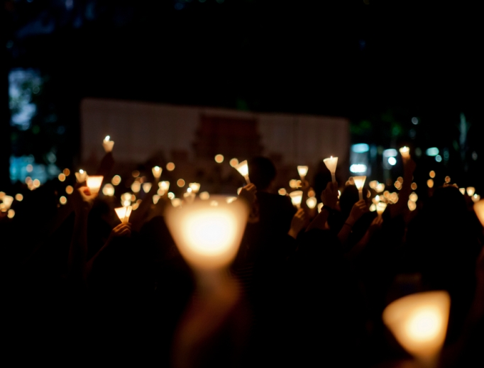 Participants hold candles at the June 4 night protest in Hong Kong.