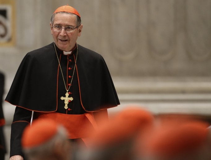 Cardinal Roger Mahony arrives for a vespers celebration in St. Peter's Basilica at the Vatican March 6, 2013.