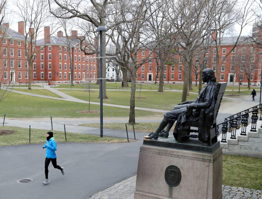 A runner crosses Harvard Yard on March 23, 2020 in Cambridge, Massachusetts.
