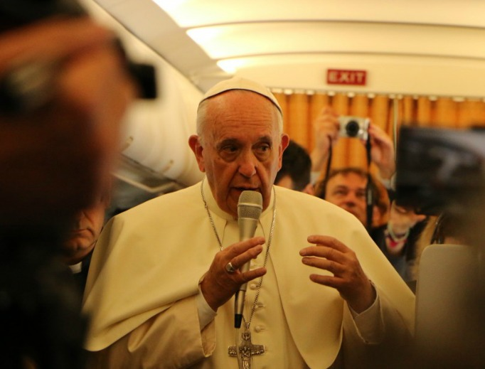 Pope Francis speaks to journalists on the papal flight from Rome to Armenia on June 24, 2016.